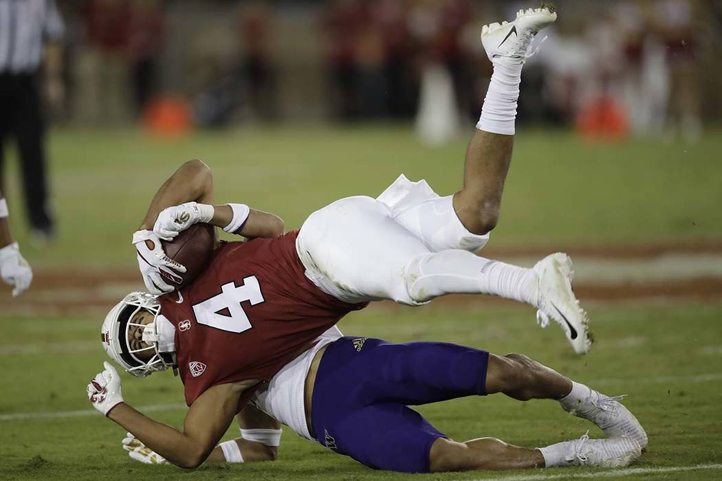 Washington's Trent McDuffie tackles Stanford's Michael Wilson (4) during the second half of an ...
