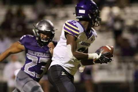 Durango High's Michael Hayword (6) runs with the ball for a touchdown as Silverado's High's run ...