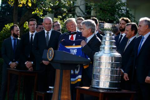 President Donald Trump is presented a team jersey by St. Louis Blues owner Tom Stillman during ...
