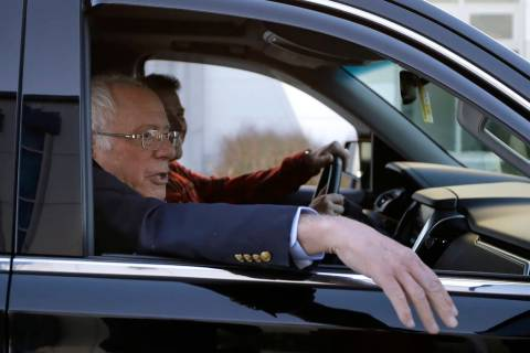 Democratic presidential candidate Sen. Bernie Sanders, I-Vt., leaves Burlington International A ...