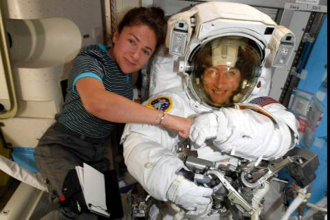 FILE - In this image released Friday, Oct. 4, 2019, by NASA, astronauts Christina Koch, right, ...