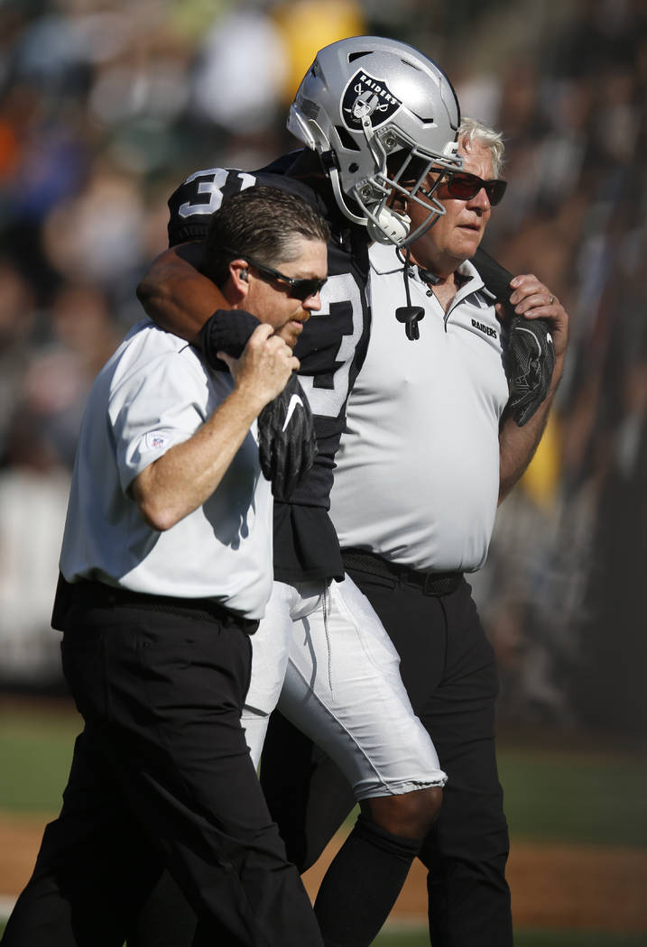 Oakland Raiders' Isaiah Johnson is assisted off the field during the first half of a preseason ...