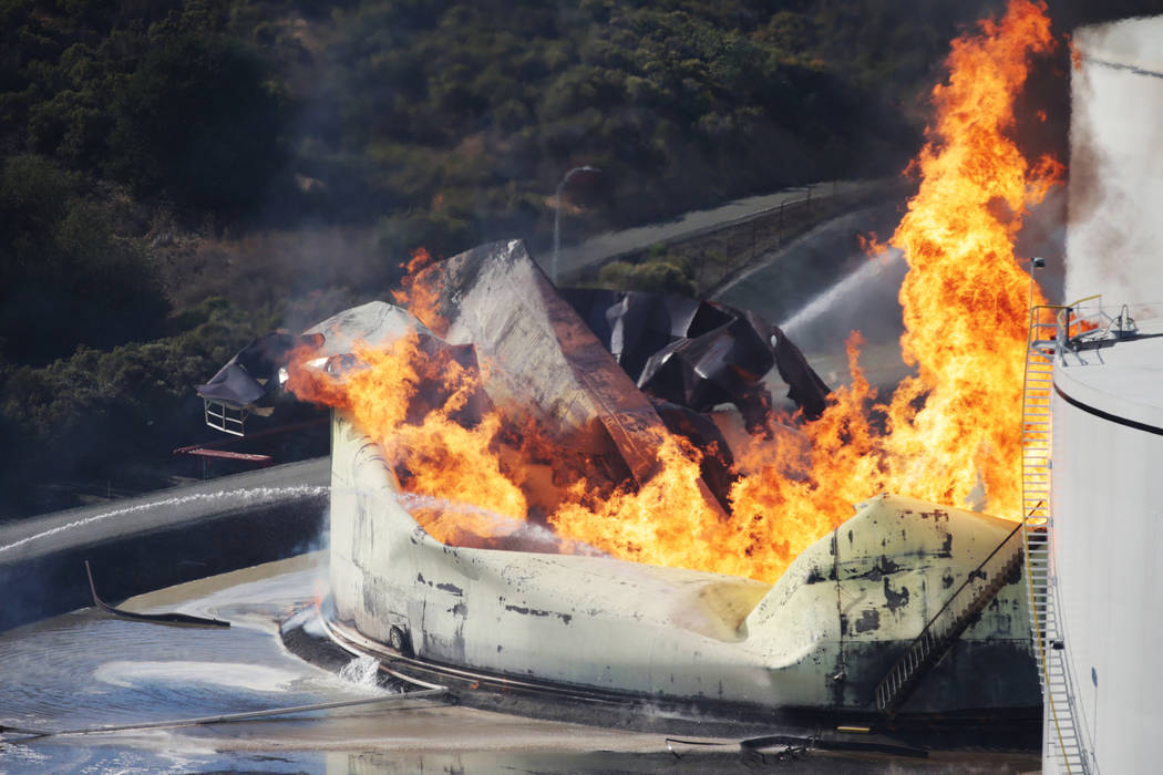 A tank burns as fire breaks out at a refinery in Crockett, Calif., on Tuesday, Oct. 15, 2019. A ...