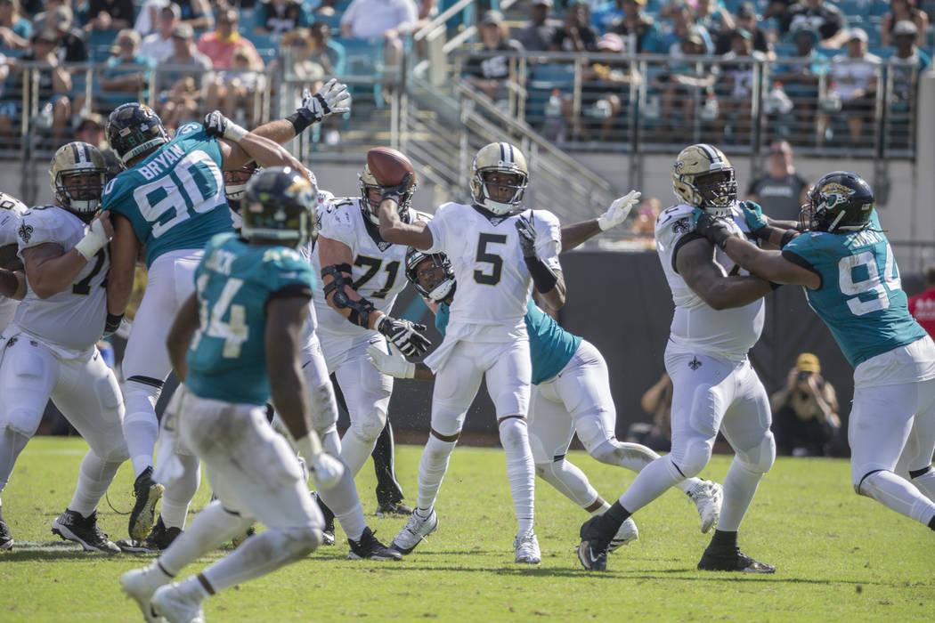 New Orleans Saints quarterback Teddy Bridgewater (5) throws a pass against the Jacksonville Jag ...