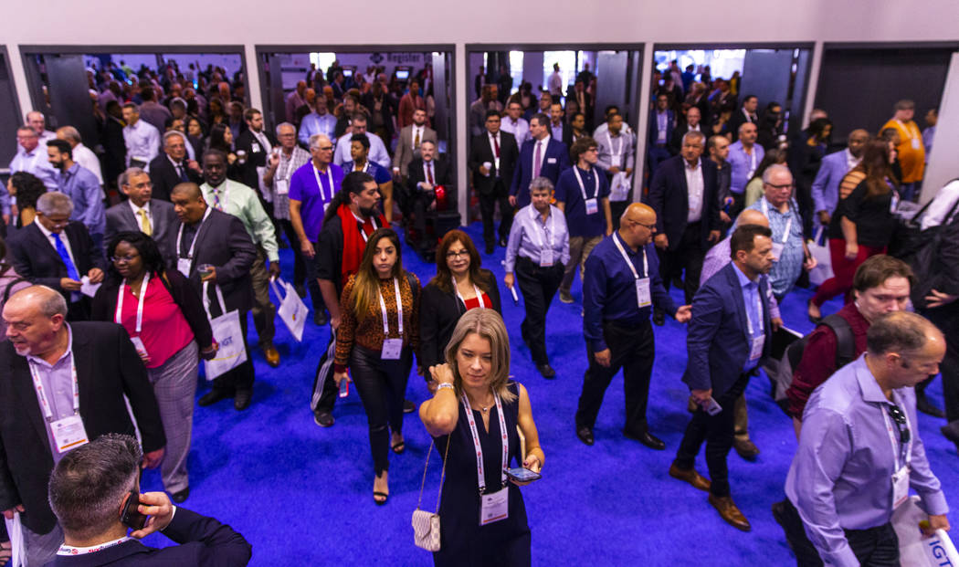 Attendees stream onto the exhibition area floor during the Global Gaming Expo 2019 at the Sands ...