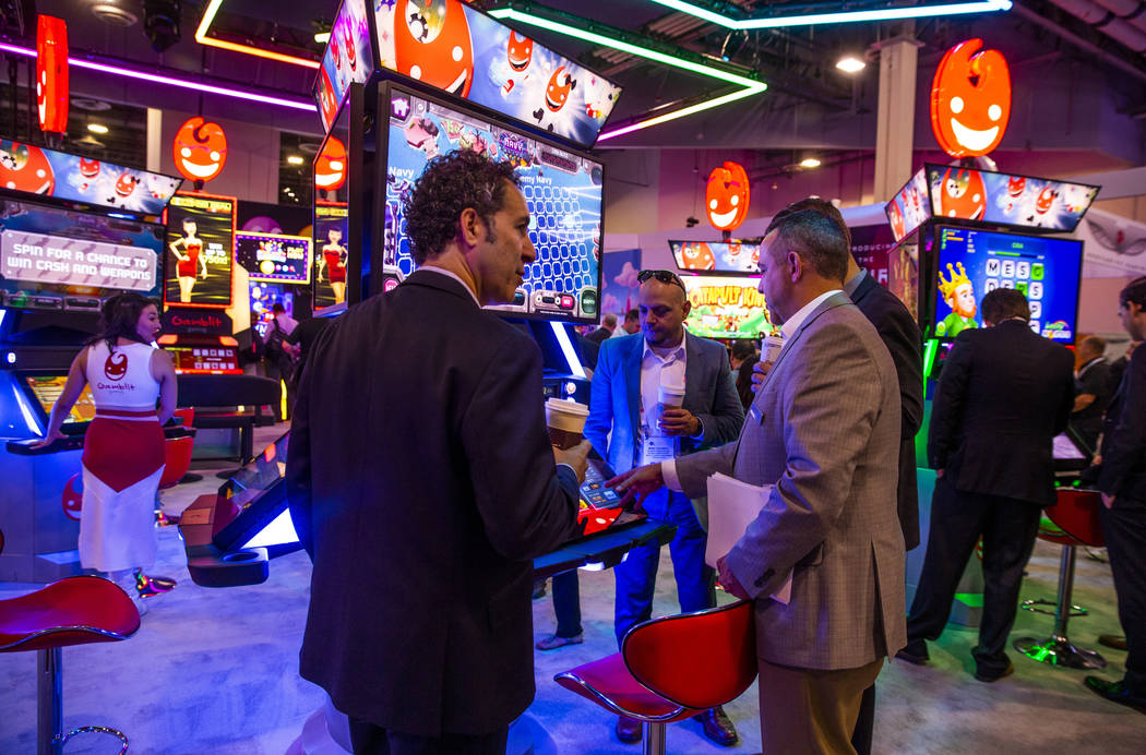 Attendees stream into the Gamblit Gaming exhibition during the Global Gaming Expo 2019 at the S ...