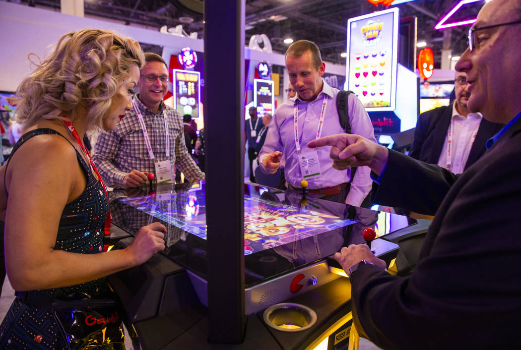 Attendees play PAC-MAN Battle Casino in the Gamblit Gaming exhibition space during the Global G ...