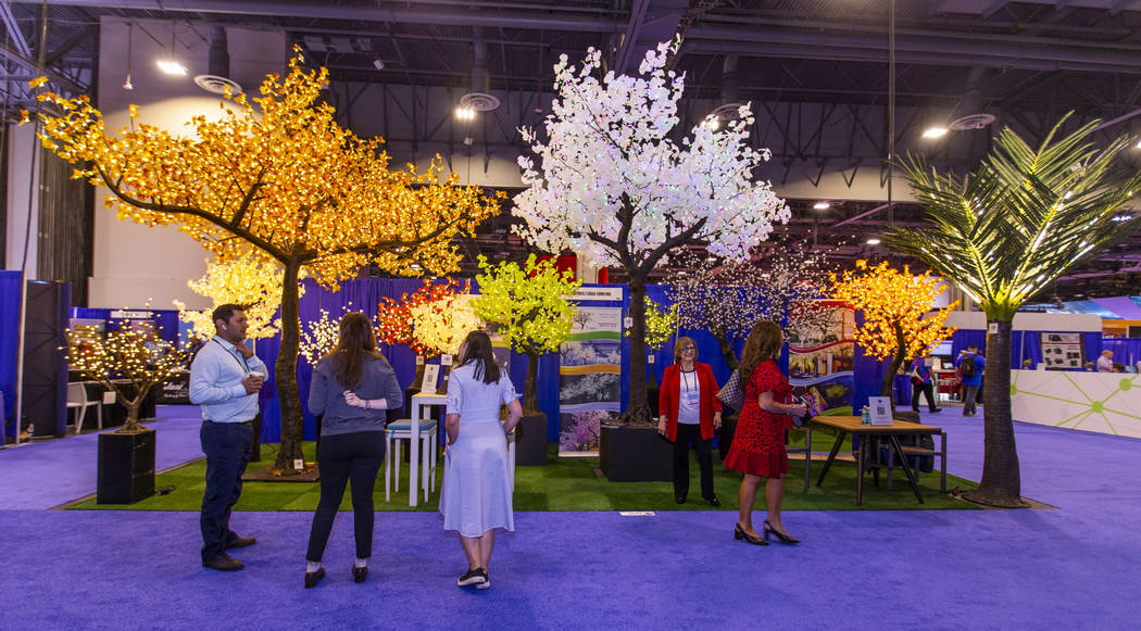 Attendees enjoy some conversation on the Illuminated Trees and Lenasi Furniture exhibition floo ...