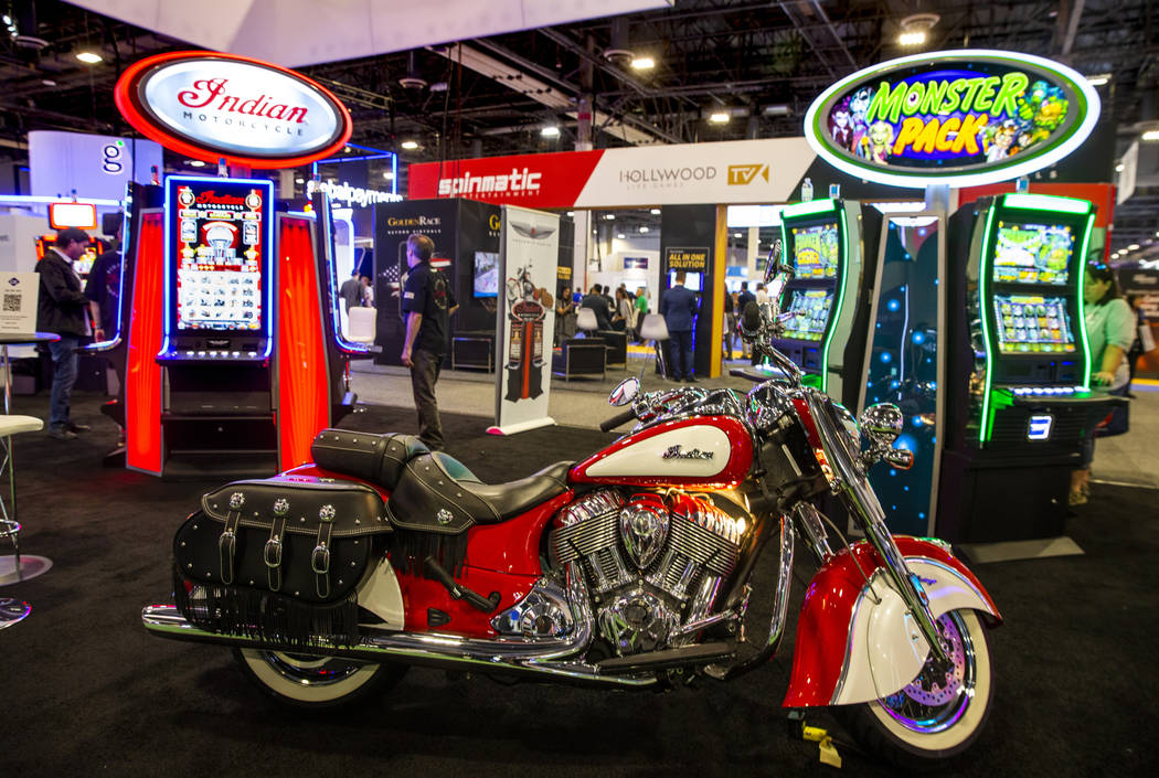 An Indian Motorcycle is on display for the Pervasive Gaming exhibition space featuring the bike ...