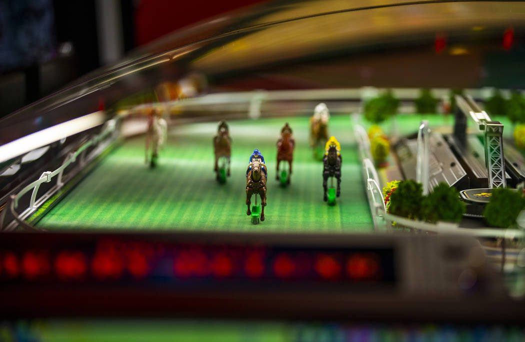Horses make their way along the track in the Fortune Cup Derby Deluxe game by Konami Gaming dur ...
