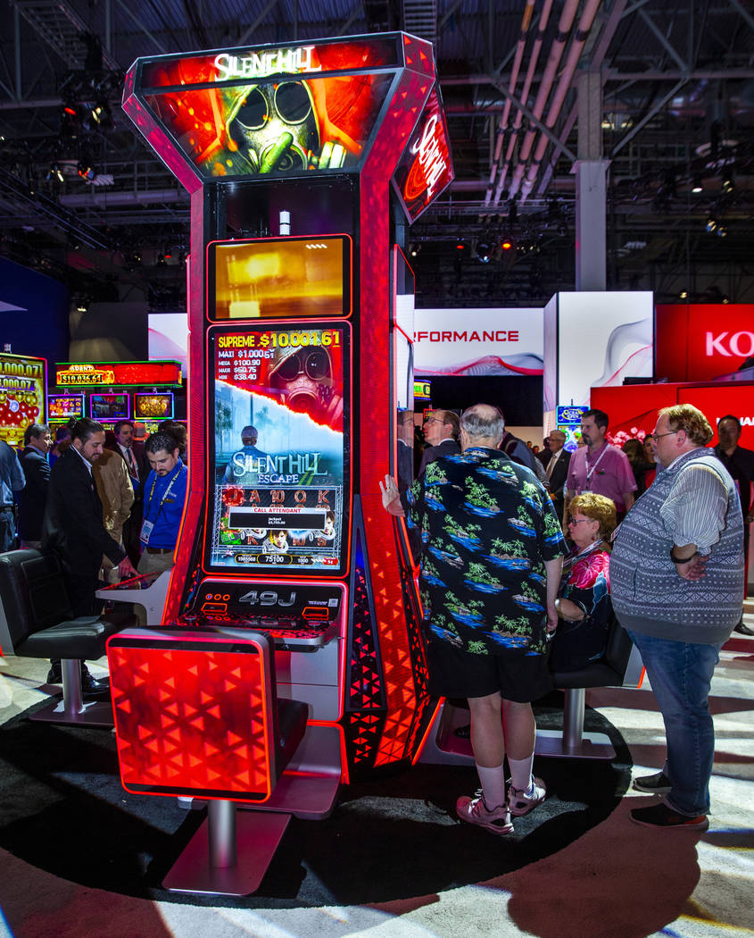 Attendees play the new Silent Hill slot game by Konami Gaming during the Global Gaming Expo 201 ...