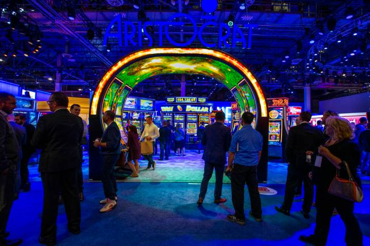 Attendees wander about the Aristocrat exhibition space entrance during the Global Gaming Expo 2 ...