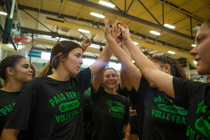 The varsity volleyball team go in for a huddle before a break during volleyball practice at Pal ...