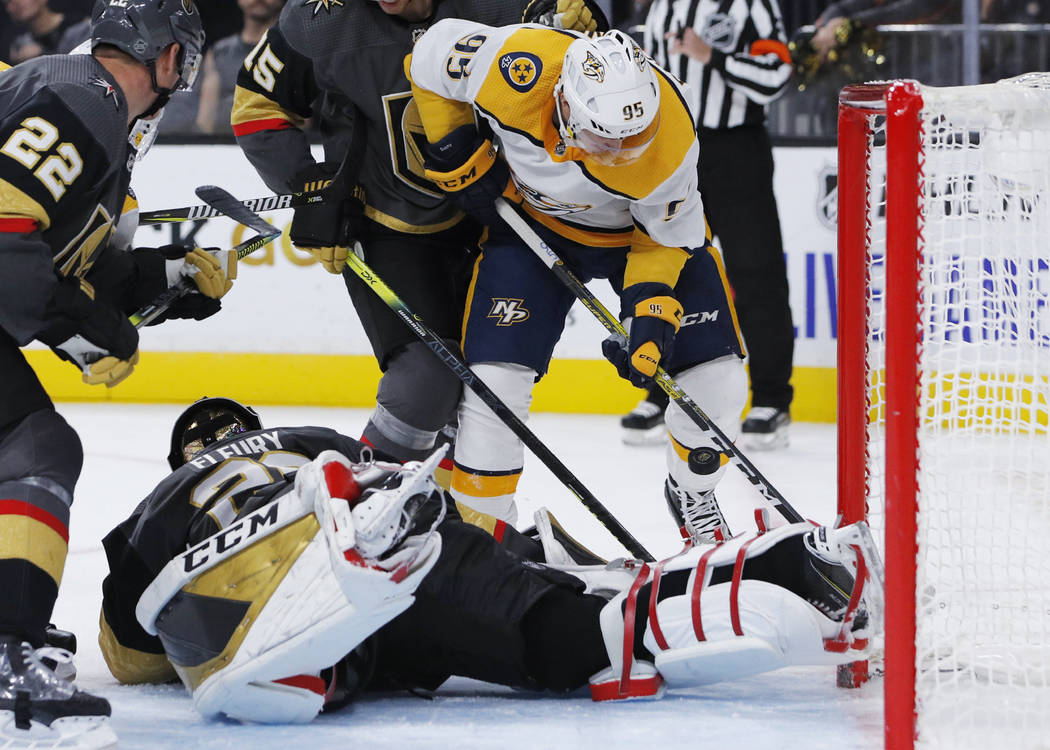 Nashville Predators center Matt Duchene (95) attempts a shot on Vegas Golden Knights goaltender ...