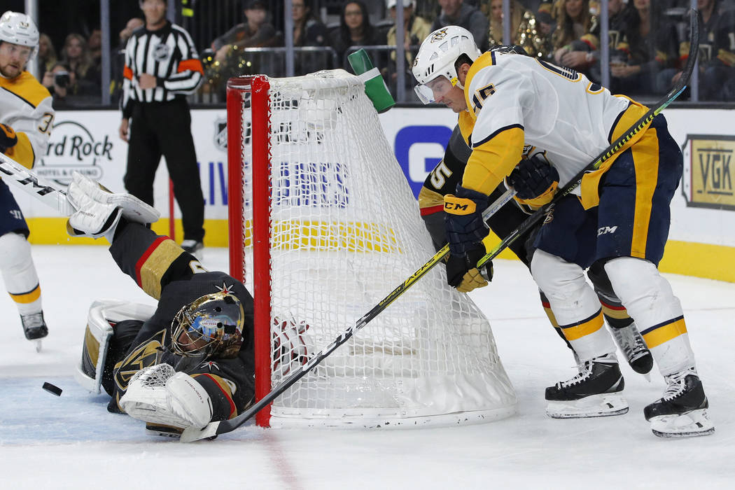Vegas Golden Knights goaltender Marc-Andre Fleury blocks a shot by Nashville Predators center M ...