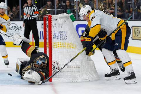 Vegas Golden Knights goaltender Marc-Andre Fleury blocks a shot by Nashville Predators center M ...