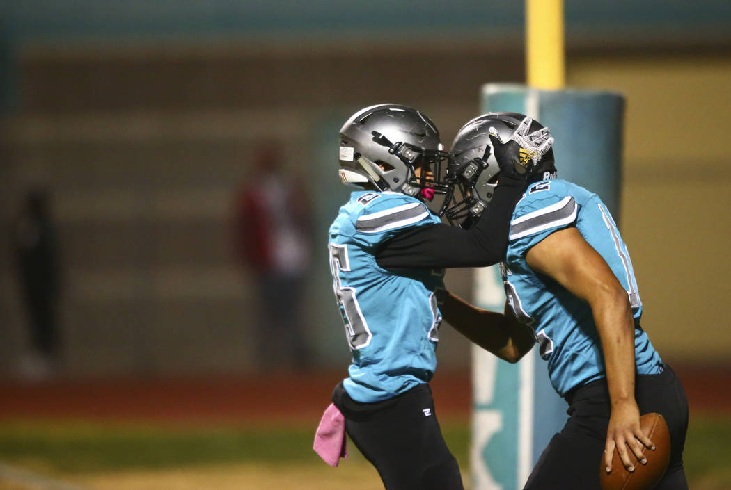 Silverado's Jeremy Alipio, left, celebrates a touchdown by Jacob Mendez during the first half o ...