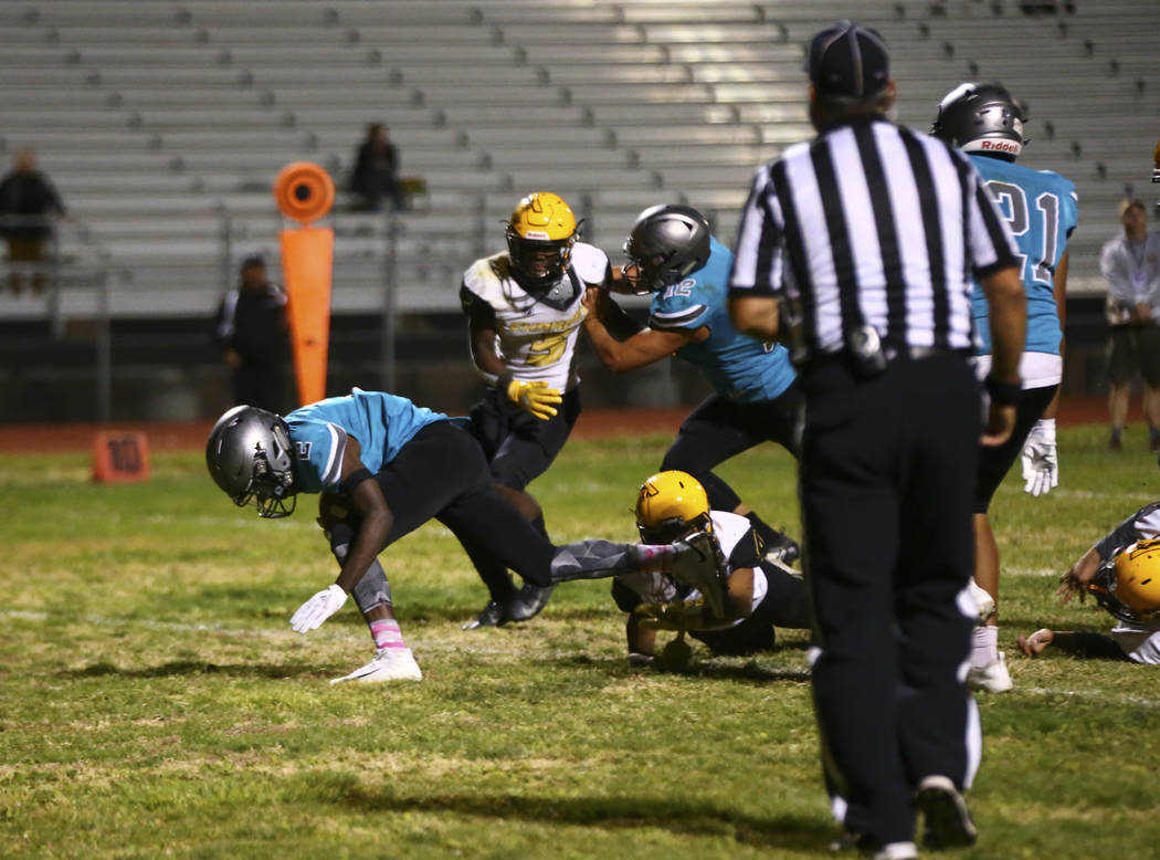 Silverado's Aginae Cunningham (2) scores a touchdown against Clark during the second half of a ...