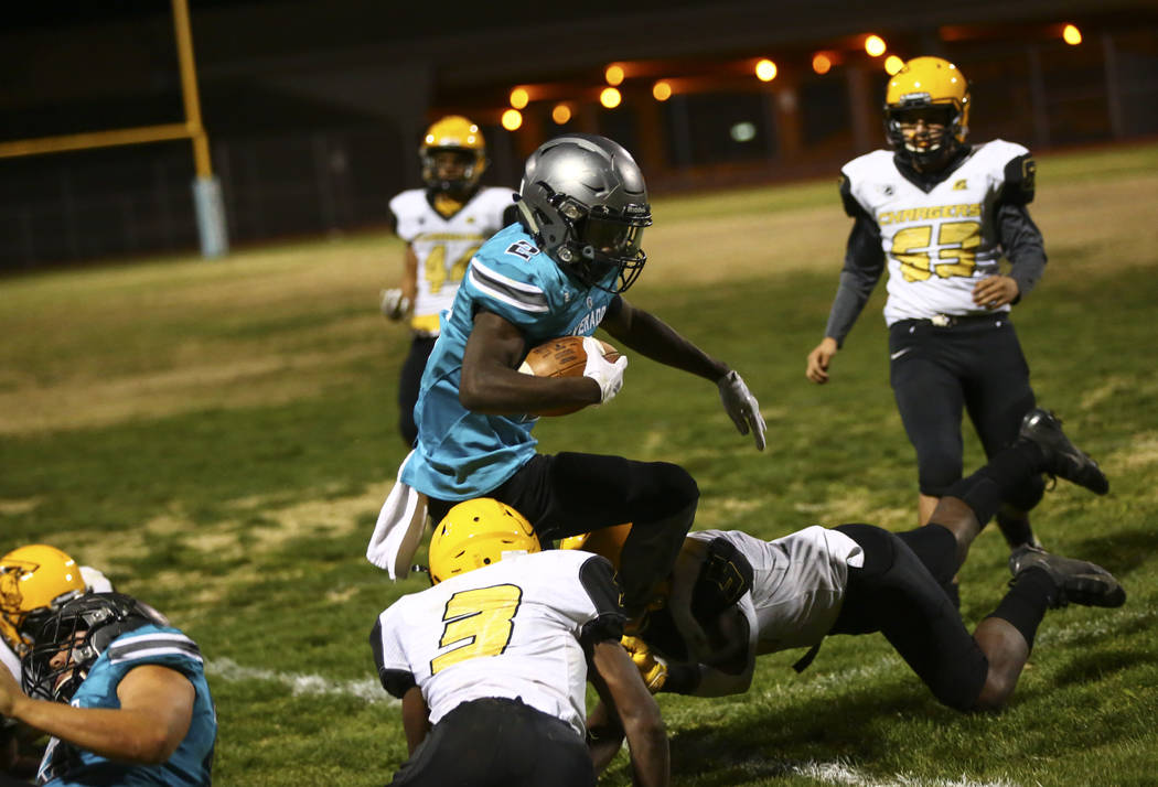Silverado's Aginae Cunningham (2) is forced out of bounds by Clark during the second half of a ...