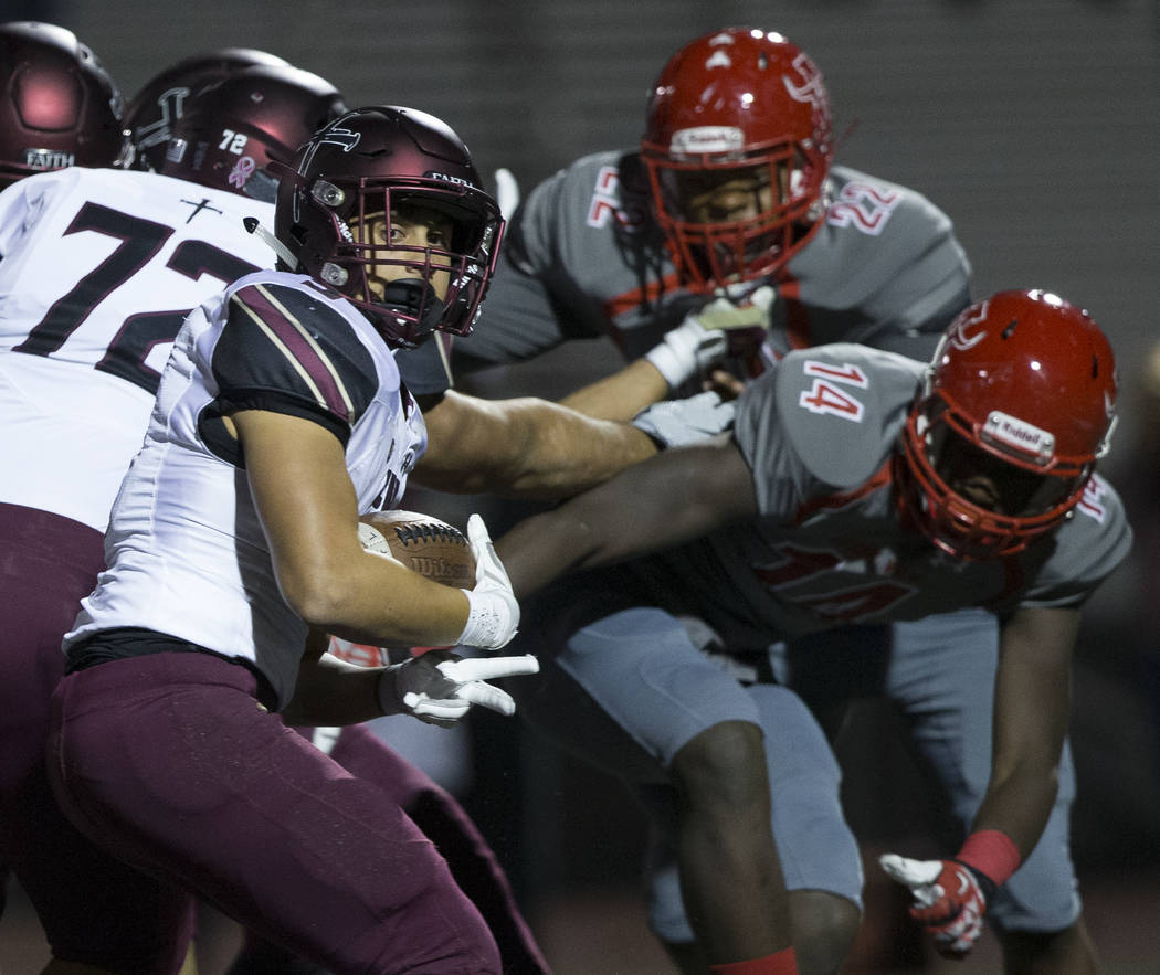 Faith Lutheran junior running back Marcos Canales (9) spins past Arbor View senior defensive en ...