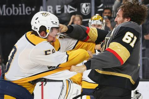 Vegas Golden Knights right wing Mark Stone (61) fights Nashville Predators defenseman Roman Jos ...