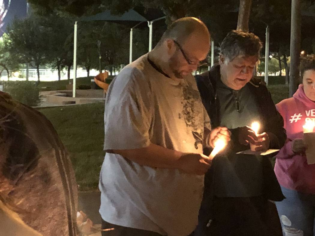 Levon Zeron, left, stands next to his father, Jose Zeron, during a vigil for the 42-year-old's ...