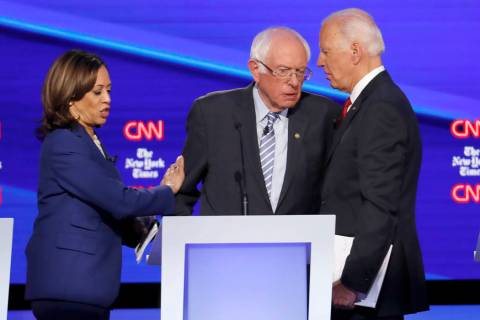 Democratic presidential candidate Sen. Kamala Harris, D-Calif., left, Sen. Bernie Sanders, I-Vt ...