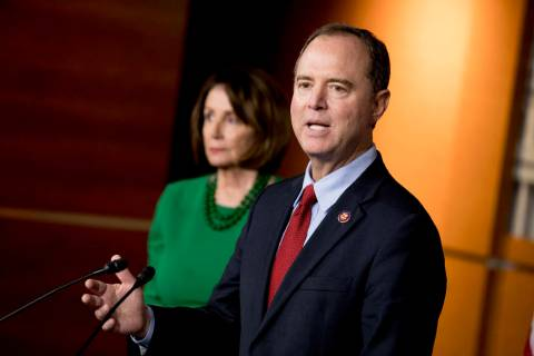 Rep. Adam Schiff, D-Calif., Chairman of the House Intelligence Committee, right, accompanied by ...