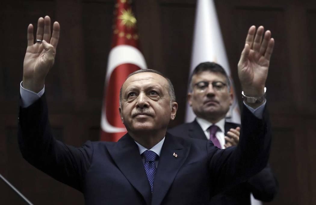 Turkish President Recep Tayyip Erdogan gestures as he addresses his ruling party legislators at ...