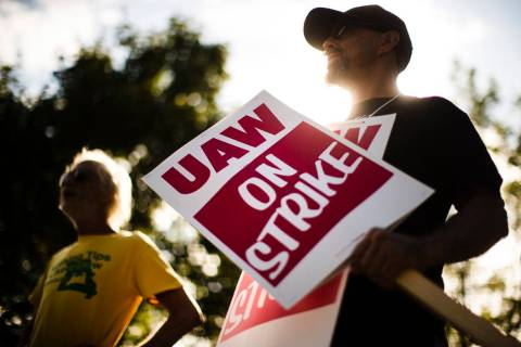 In a Sept. 16, 2019 file photo, union members picket outside a General Motors facility in Langh ...