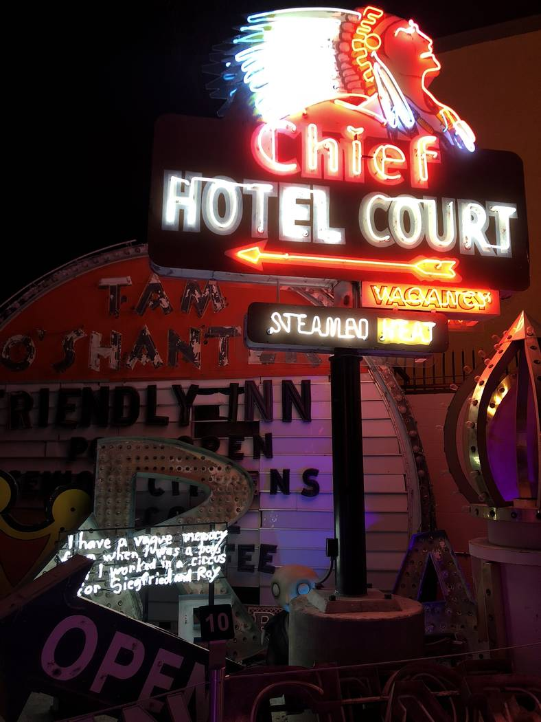 """Penguin Boy"" lurks inconspicuously in a corner at ""Lost Vegas: Tim Burton @ The Neon Museum ..."