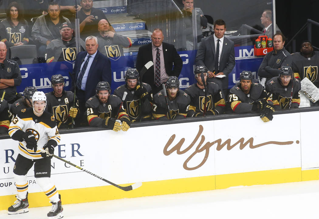 Golden Knights head coach Gerard Gallant, center, looks on during the third period of an NHL ho ...