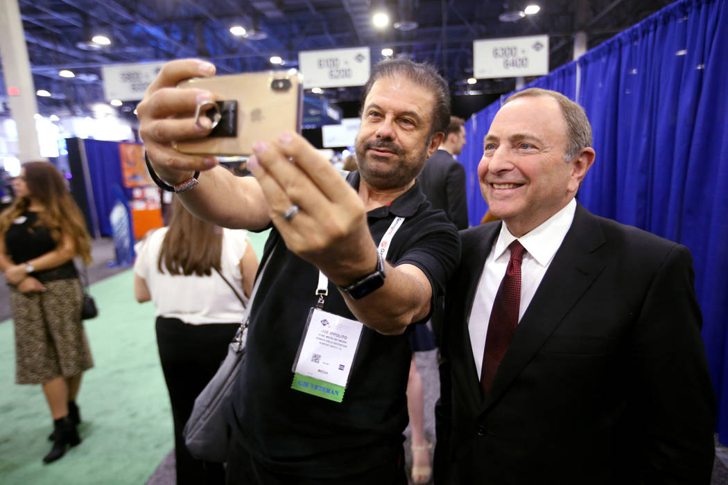NHL commissioner Gary Bettman gets a photo with Joe Ippolito, of Newport Beach, Calif., after a ...