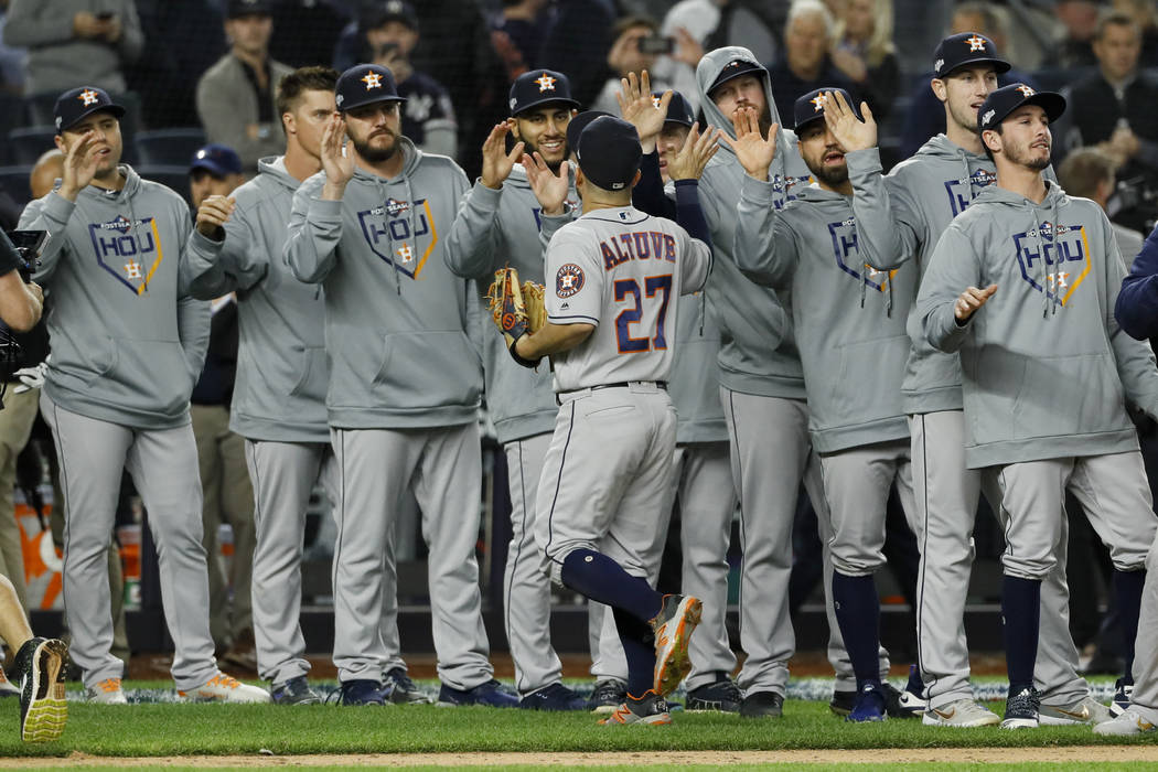 Houston Astros second baseman Jose Altuve celebrates with teammates after their 4-1 win against ...