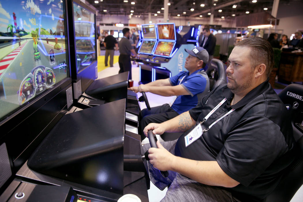 Francis Steele III, right, plays the Lucky Karts game while Francis Steele, both of Oroville, C ...