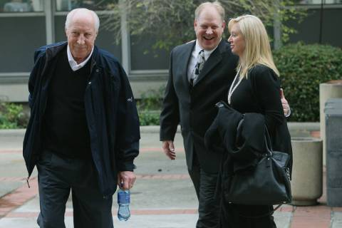 Former Oakland Raiders great Fred Biletnikoff, left, his son Fred Biletnikoff, Jr., center, and ...