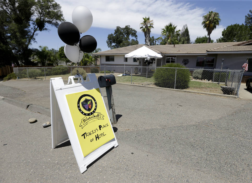Silver and black balloons flutter in the breeze outside Tracey's Place of Hope on Thursday, Jul ...