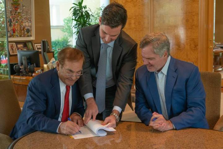 Phil Ruffin, left, signs a deal to purchase Circus Circus from MGM Resorts International alongs ...