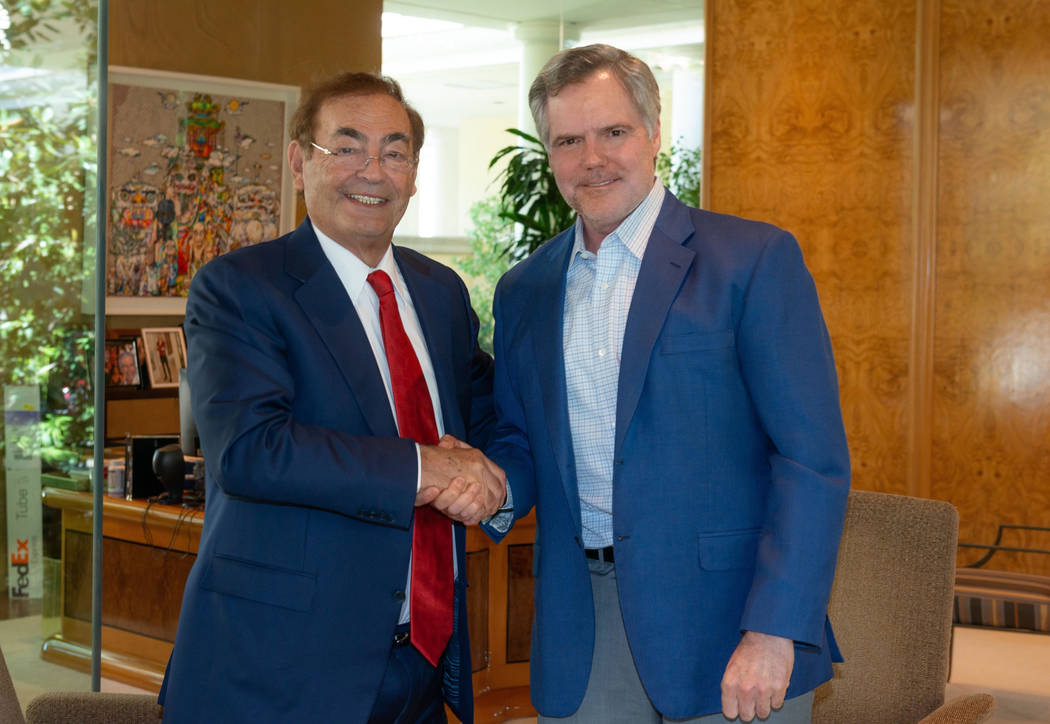 Phil Ruffin, left, shakes hands with MGM Resorts International CEO Jim Murren on Monday, Oct. 1 ...