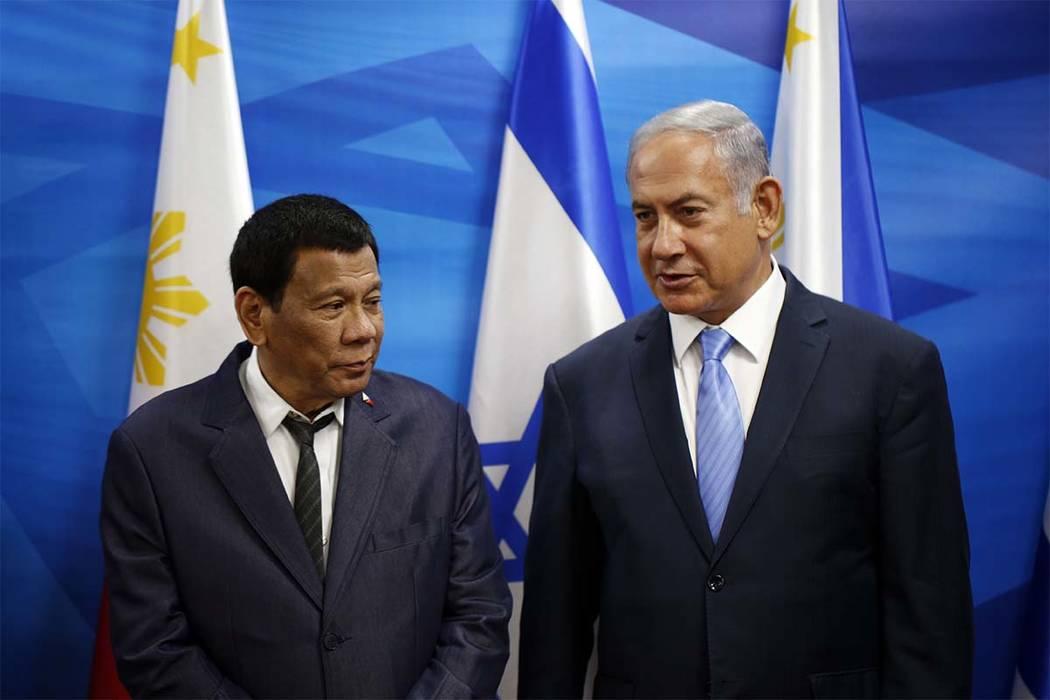 Israeli Prime Minister Benjamin Netanyahu, right, stands next to Philippine President Rodrigo D ...