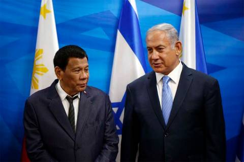 Israeli Prime Minister Benjamin Netanyahu, right, stands next to Philippine President Rodrigo D ...