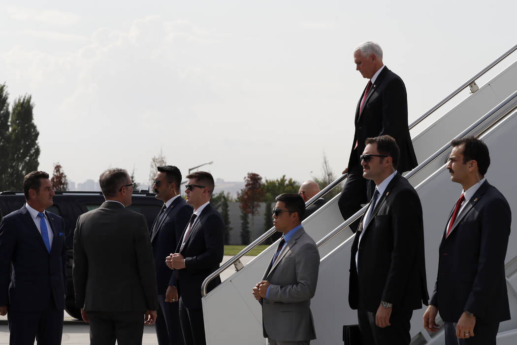 Security officers stand by Vice President Mike Pence arriving in Ankara, Turkey, Thursday, Oct. ...