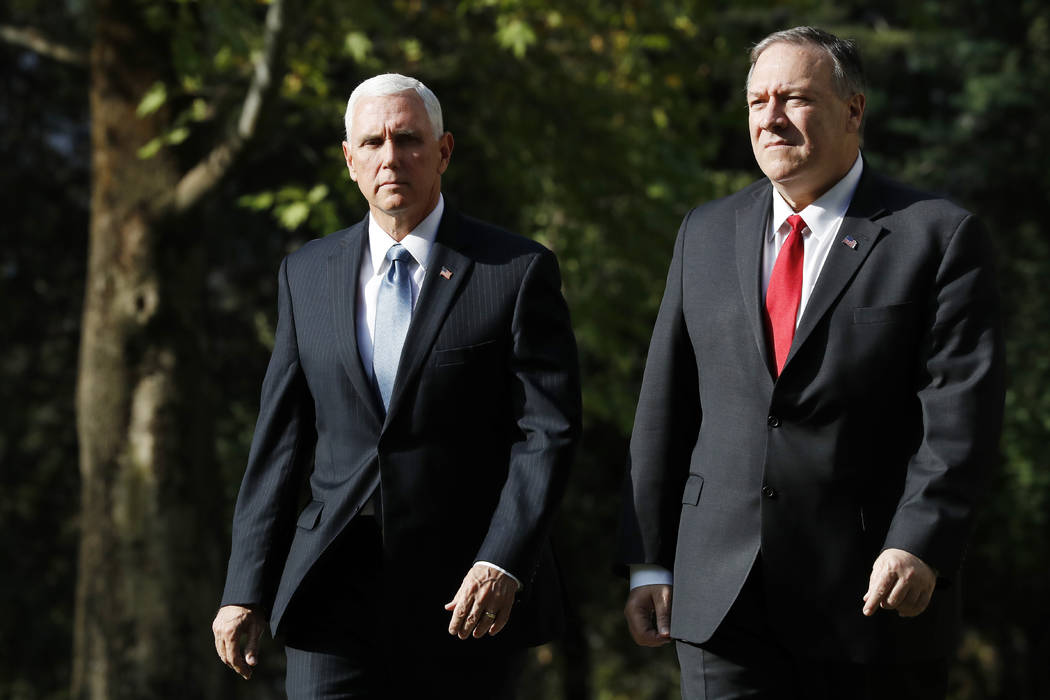 Vice President Mike Pence, left, and Secretary of State Mike Pompeo leave the Ambassador&#x2019 ...