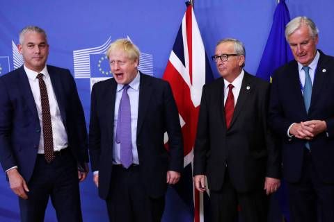 Britain's Brexit Secretary Stephen Barclay (from left), British Prime Minister Boris Johnson, E ...