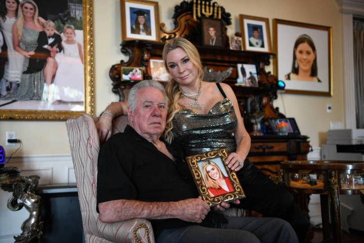 David and Jackie Siegel, hold a photo of their daughter at their home in Windermere, Fla., on O ...