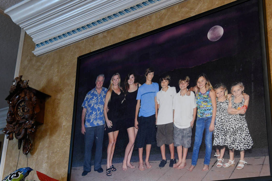 A portrait of the Siegel family hangs in the kitchen of their home in Windermere, Fla. on Oct. ...