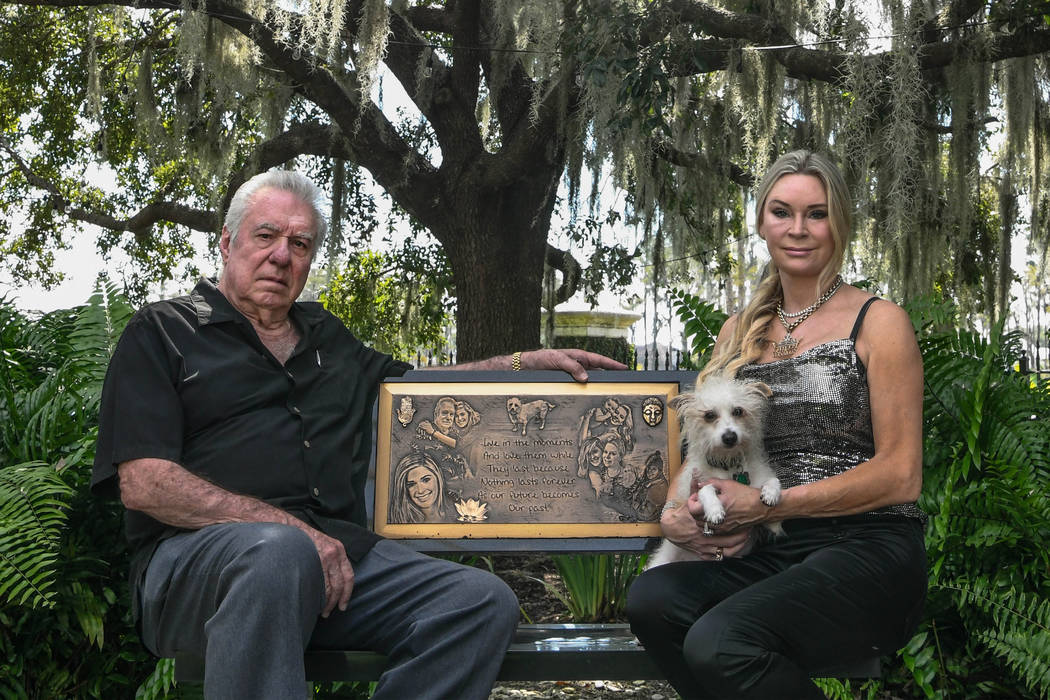 David and Jackie Siegel sit on a memorial bench made for their daughter Victoria in the backyar ...