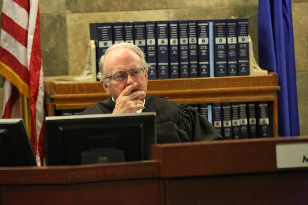 Judge Mark Denton listens to arguments from attorneys for the Siegel Group, the company that cl ...