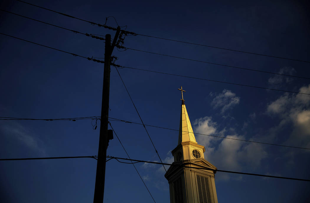 n a Tuesday, April 11, 2017, file photo, the sun sets on a Baptist church in Georgia. According ...