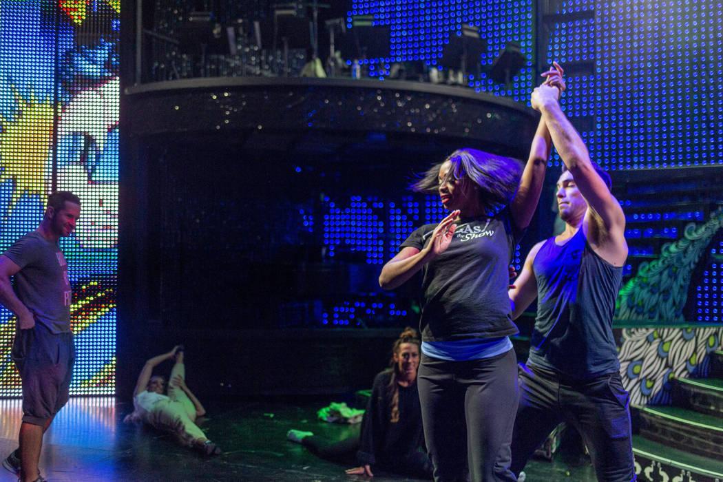 """Vegas! The Show"" dancers Lauren Clark, center right, and Nick Miller, right, run thr ..."